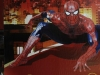 A Thai student, left, walks past a billboard advertisement showing a Spiderman picture as the latest figure in the Bangkok's Madame Tussaud Wax Museum Tuesday, April 5, 2011. (AP Photo/Sakchai Lalit)